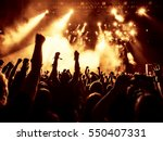 silhouettes of concert crowd in ... | Shutterstock . vector #550407331