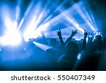 silhouettes of concert crowd in ... | Shutterstock . vector #550407349