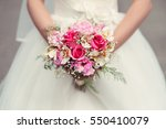 bride holding her wedding... | Shutterstock . vector #550410079