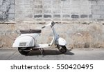 White  Scooter Stands Parked...