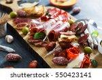 cured meat platter of... | Shutterstock . vector #550423141