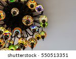 Small photo of Glass lamp adorned with glass colorful Indian style
