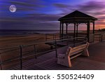 a moon over boardwalk by the sea | Shutterstock . vector #550524409