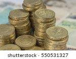 British Pound Coins Against A...