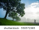 man on bicycle ride through... | Shutterstock . vector #550572385
