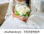 bride with bouquet  closeup | Shutterstock . vector #550589809