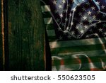 usa flag on a wood surface | Shutterstock . vector #550623505