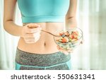 young woman eating a healthy... | Shutterstock . vector #550631341