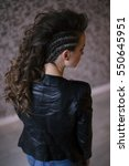 Small photo of Punk rock style or halloween make-up. Fashion woman model face with bright glamour makeup. Perfect skin, black gloss eyeshadows on eyes and dark brown glossy lips visage. back view