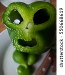 Small photo of Pepper with alien face, Food alive, funny character