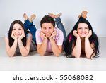 three friends lying  down on... | Shutterstock . vector #55068082