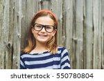 outdoor portrait of a cute... | Shutterstock . vector #550780804
