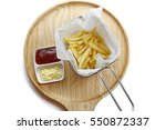 french fries  potato chips  on... | Shutterstock . vector #550872337