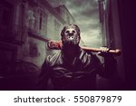 psycho man in hockey mask with... | Shutterstock . vector #550879879