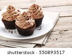 Tasty Cupcakes On A Grey Wooden ...