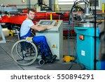 disabled worker in wheelchair... | Shutterstock . vector #550894291