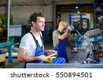 two worker in factory on the... | Shutterstock . vector #550894501