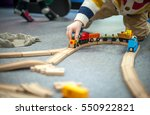 child boy play with wooden... | Shutterstock . vector #550922821