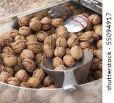 Greek walnuts on display at a Greek market stall. - stock photo