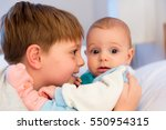 six year old toddler sharing... | Shutterstock . vector #550954315