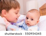 six year old toddler sharing... | Shutterstock . vector #550954345