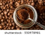 ground coffee in a metal spoon... | Shutterstock . vector #550978981