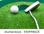 golf ball and putter at the... | Shutterstock . vector #550998025