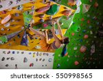 young woman bouldering in... | Shutterstock . vector #550998565