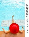 woman in big hat relaxing on... | Shutterstock . vector #551018155