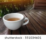 Focus Is White Teacup On The...