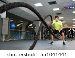 man with battle ropes exercise... | Shutterstock . vector #551041441