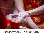wedding rings.he put the... | Shutterstock . vector #551042389
