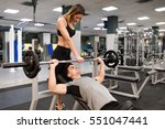 female personal trainer helping ... | Shutterstock . vector #551047441