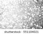 black bokeh texture on black... | Shutterstock . vector #551104021