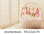 easter basket with eggs and... | Shutterstock . vector #551116174