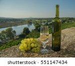 bottle and glass of white wine ... | Shutterstock . vector #551147434