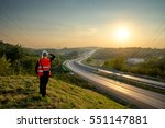 the man in an orange safety... | Shutterstock . vector #551147881