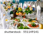 beautifully served festive... | Shutterstock . vector #551149141