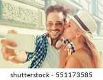 young couple taking a photo of... | Shutterstock . vector #551173585
