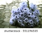Bouquet Of Blue Rose Lying On...