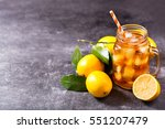 glass jar of iced tea with... | Shutterstock . vector #551207479