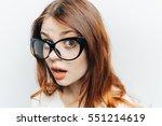 surprised woman closeup looking ... | Shutterstock . vector #551214619