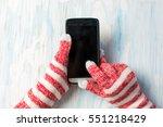 hands using smart phone in... | Shutterstock . vector #551218429