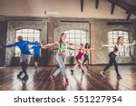 Stock photo group of sportive people training in a gym multi ethnic group of athletes doing fitness 551227954