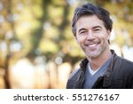 handsome mature happy man... | Shutterstock . vector #551276167
