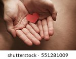 red heart give out hand. a gift ... | Shutterstock . vector #551281009