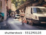 messenger delivering parcel ... | Shutterstock . vector #551290135