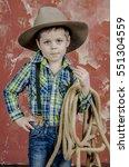 Little Baby Boy In A Cowboy...