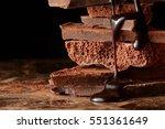 heap of broken pieces chocolate   Shutterstock . vector #551361649