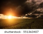 corn field with stormy clouds... | Shutterstock . vector #551363407